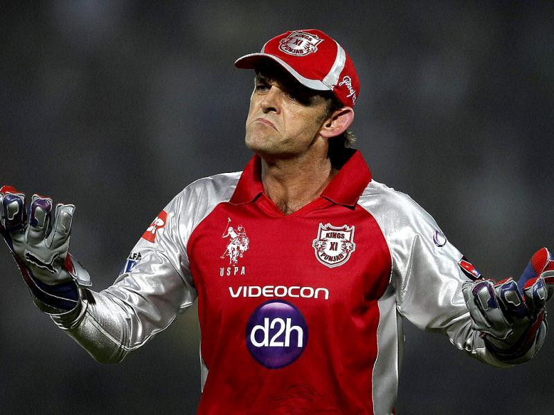 Kings XI Punjab's Adam Gilchrist reacts to his bowler James Faulkner, (unseen) during their IPL-5 match against Rajasthan Royals in Jaipur. (PTI Photo/Aman Sharma)
