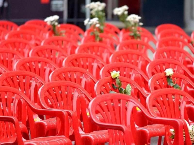 Flowers are left on chairs lined up along the main street in Sarajevo symbolizing 11541 victims of Bosnia War as Bosnians marked the anniversary of the bloody conflict with songs and remembrance. AFP Photo/Elvis Barukcic