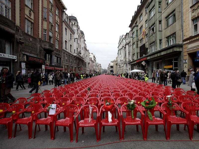 Red chairs are displayed along a main street in Sarajevo as the city marks the 20th anniversary of the start of the Bosnian war. AP Photo/Amel Emric