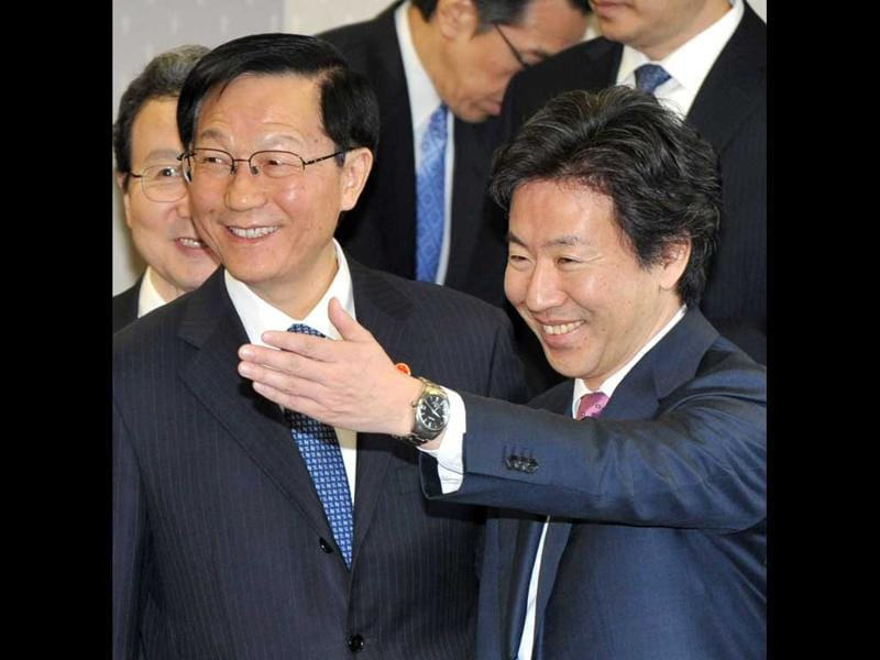 Japanese finance minister Jun Azumi escorts his Chinese counterpart Xie Xuren after a photo session priot to their meeting at the finance ministry in Tokyo. Japan and China held a fouth round of bilateral