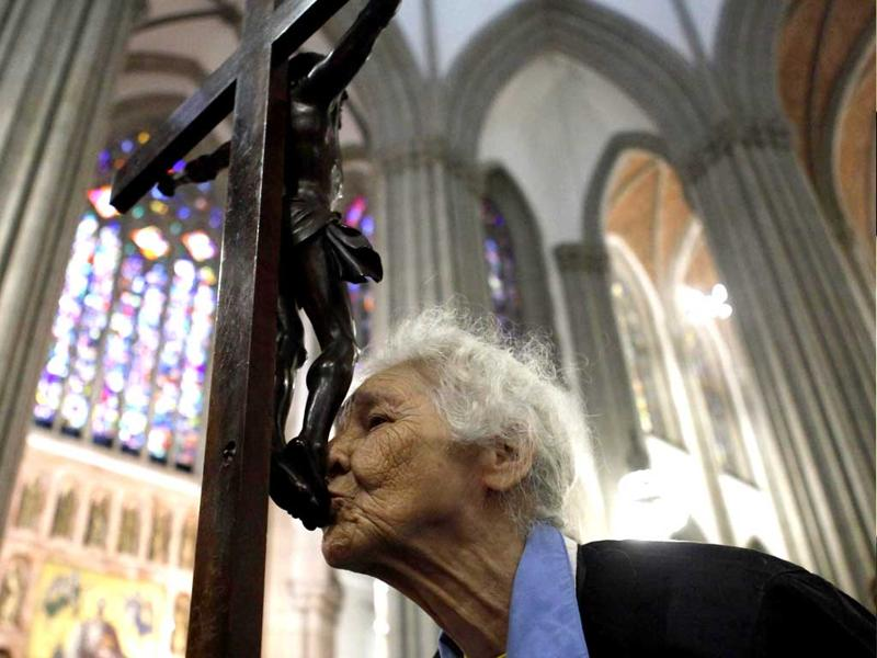 A Brazilian Catholic kisses a crucifix before a procession to mark the death of Jesus Christ on Good Friday inside the Se Cathedral at downtown Sao Paulo. REUTERS/Nacho Doce