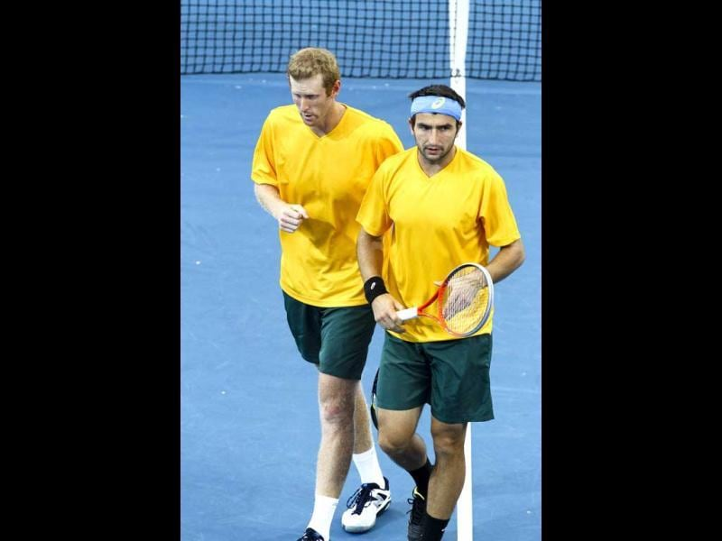Australia's Chris Guccione (L) gestures as teammate Marinko Matosevic (R) looks on during their men's doubles Davis Cup tennis match against South Korea in Brisbane. AFP Photo/Patrick Hamilton