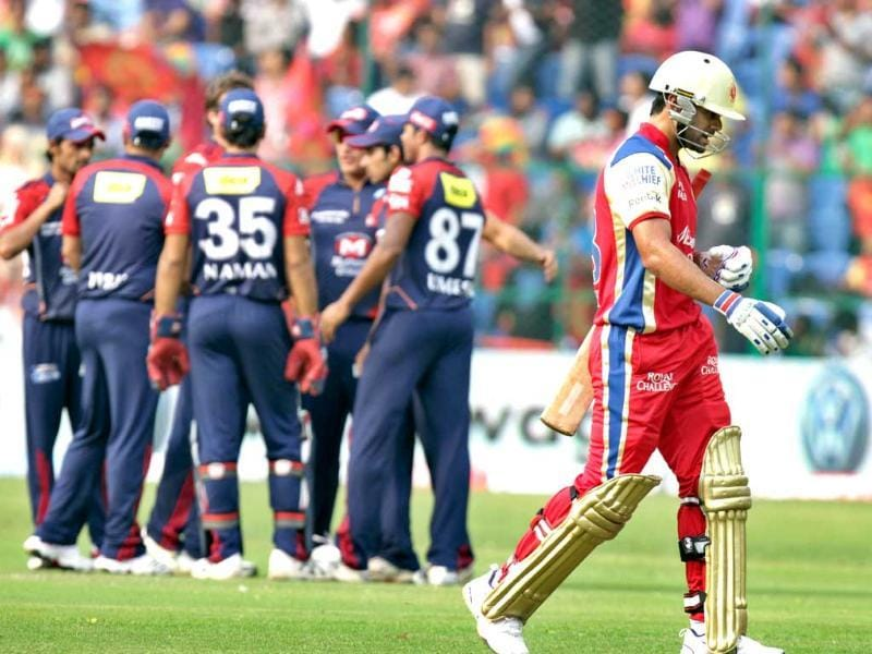 Delhi Daredevils team members celebrate the dismissal of Royal Challengers Bangalore batsman Virat Kohli during the Indian Premier League 2012 match at the M Chinnaswamy stadium in Bangalore. HT Photo/Rajnish Katyal