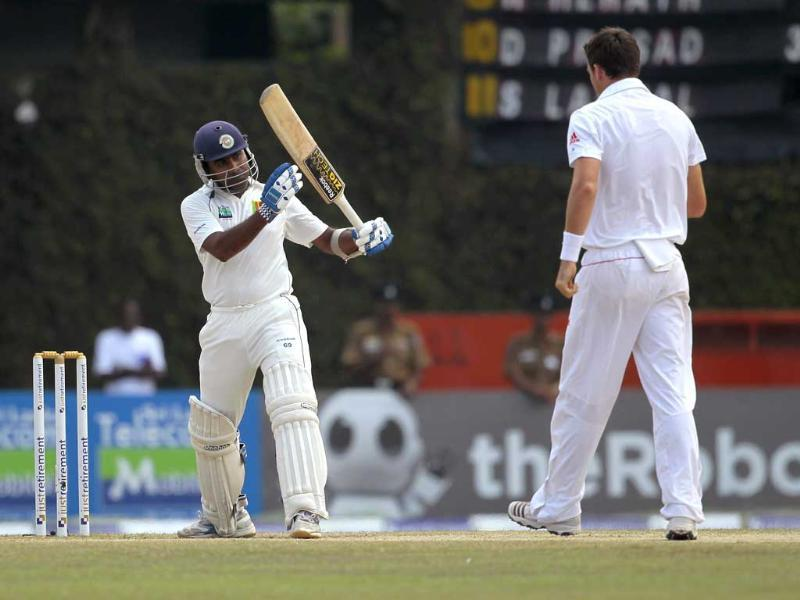 Sri Lankan captain Mahela Jayawardene (L) signals for a decision review over an leg before wicket out as England's bowler James Anderson looks on during the final day of the second Test cricket match in Colombo. AP Photo/Eranga Jayawardena