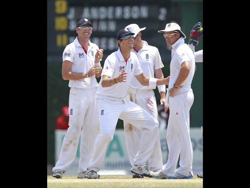 England's Steven Finn (C) shares a moment with captain Andrew Strauss (R) and James Anderson during the last day of final Test cricket match against Sri Lanka in Colombo. Reuters/Dinuka Liyanawatte