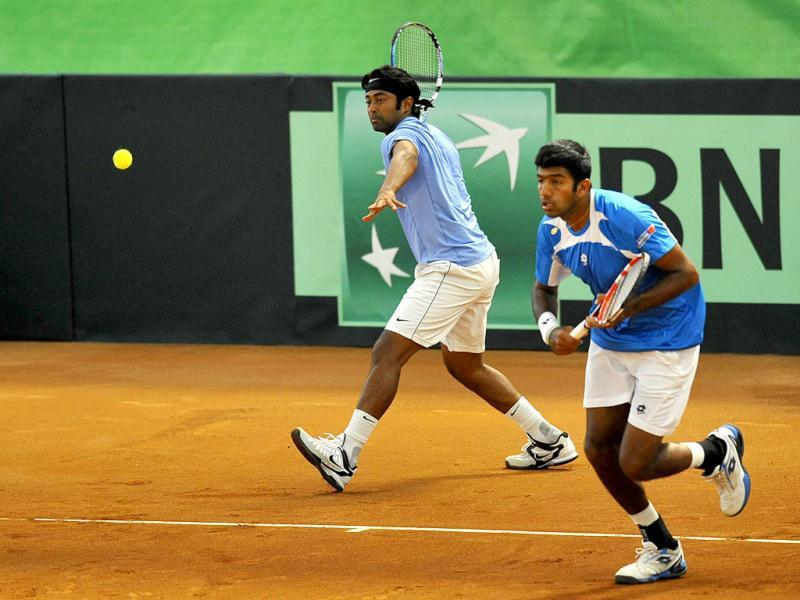Leander Paes, left, and Rohan Bopanna are in action during the Davis Cup match between Uzbekistan and India in Namangan, 300 kms (186.42 miles) east of the Uzbek capital, Tashkent, Saturday, April 7, 2012. Uzbek tennis players won with the score 7-6, 6-4, 3-6, 6-3. AP