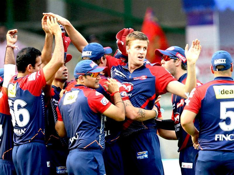 Delhi Daredevils Morne Morkel celebrates with teammates the wicket of Andrew McDonald of Royal Challengers Bangalore during their IPL 5 match in Bengaluru. (PTI Photo/Shailendra Bhojak)