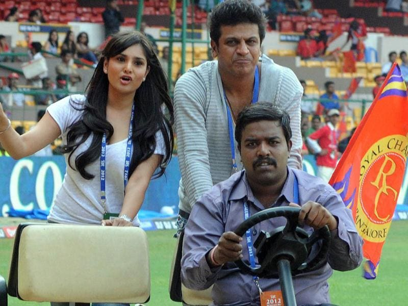 Royal Challengers Bangalore brand ambassadors Kannada actor Shiv Raj Kumar and Ramya at M Chinnaswamy stadium in Bangalore.