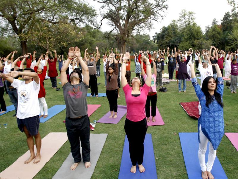 People participate in a Yogathon, a nation-wide initiative by the Art of Living to create awareness about yoga, to mark World Health Day in New Delhi. (AP Photo/Tsering Topgyal