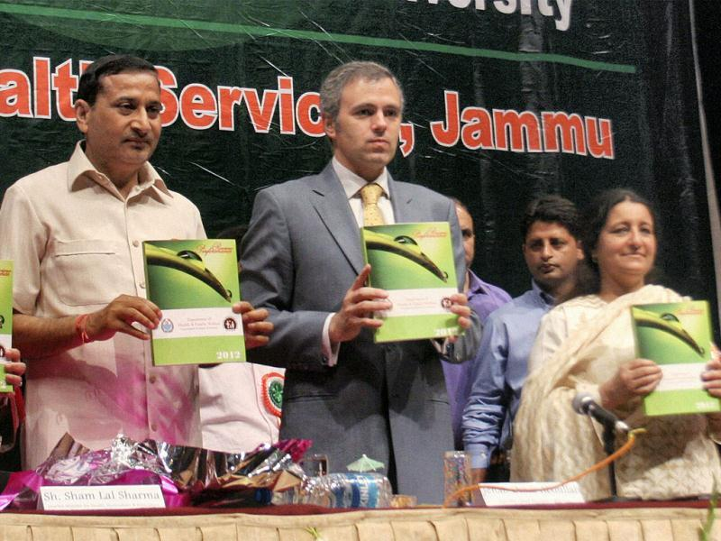 Jammu and Kashmir chief minister Omar Abdullah releases a book during a function organised to mark the World Health Day 2012 in Jammu. PTI