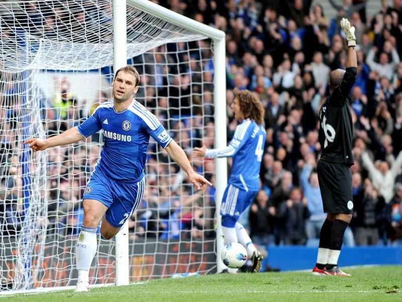 Chelsea's Serbian defender Branislav Ivanovic (L) celebrates scoring the opening goal of the English Premier League football match between Chelsea and Wigan Athletic at Stamford Bridge in London. AFP