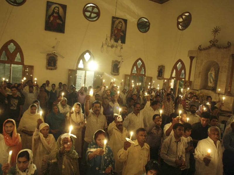 Pakistanis hold candles during an Easter vigil Mass in a church in Lahore, Pakistan. AP Photo/KM Chaudary
