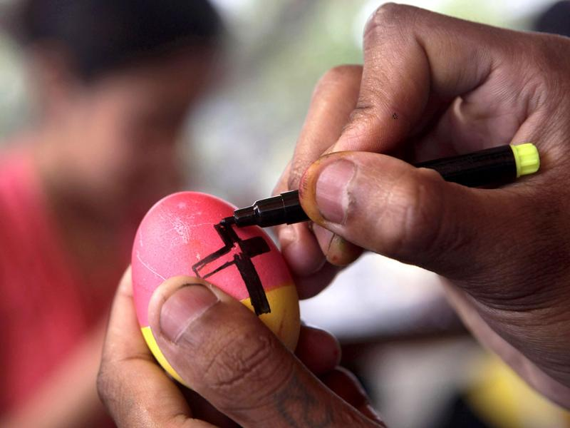 A Christian girl decorates an Easter egg in preparation of Easter Sunday in Guwahati, India. AP Photo/Anupam Nath