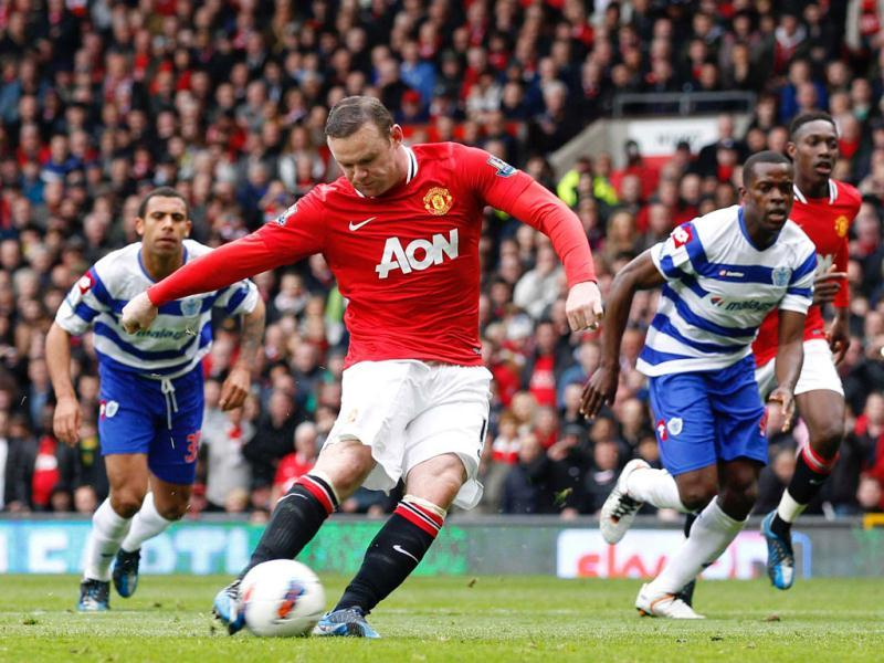 Manchester United's Wayne Rooney scores a penalty against Queens Park Rangers during their English Premier League match at Old Trafford in Manchester. Reuters
