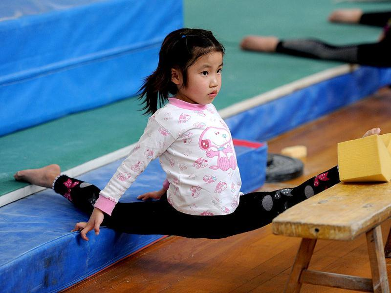 Young Chinese gymnast trains at a special sport school in Hefei, east China's Anhui province. Potential gymnasts embark on a gruelling schedule which aims to create champions. AFP photo