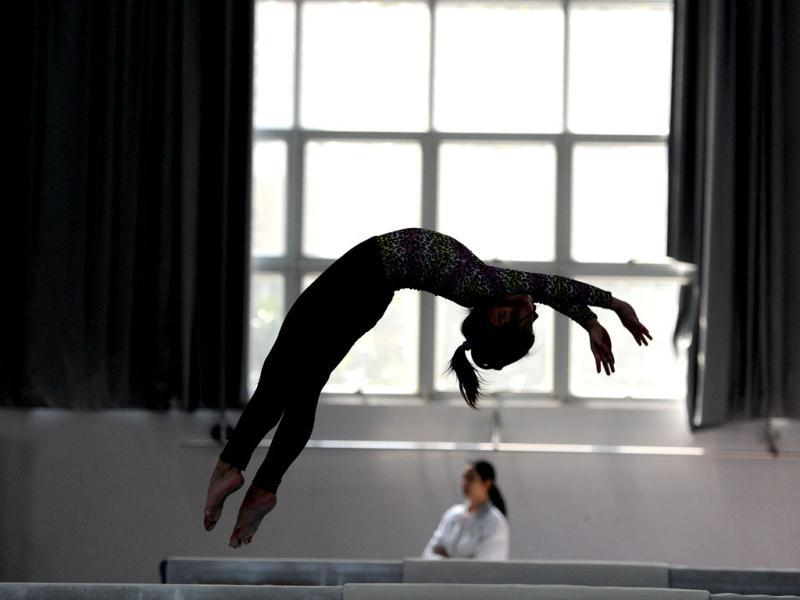 Young Chinese gymnasts train at a special sport school in Hefei, east China's Anhui province. Potential gymnasts embark on a gruelling schedule which aims to create champions. AP Photo