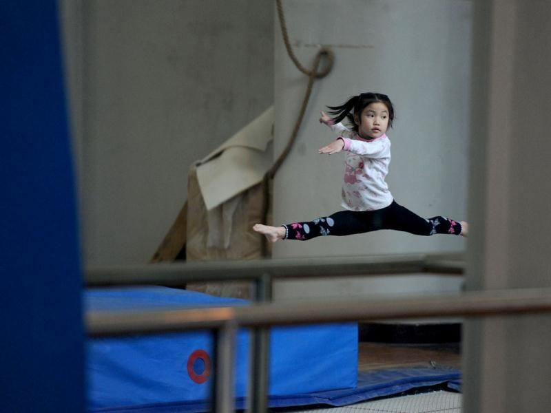 Young Chinese gymnast trains at a special sport school in Hefei, east China's Anhui province. Potential gymnasts embark on a gruelling schedule which aims to create champions. AP Photo
