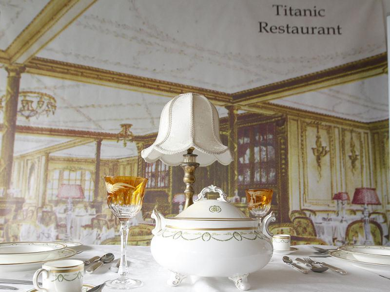 A mock up of a first class dinning table from the Titanic is seen in the check in area for the MS Balmoral Titanic memorial cruise in Southampton, England, . Nearly 100 years after the Titanic went down, a cruise with the same number of passengers aboard is setting sail to retrace the ship's voyage, including a visit to the location where it sank. (AP Photo)