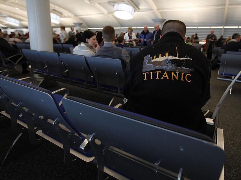 A passenger wears a Titanic film memorabilia jacket as he waits to check in for the MS Balmoral Titanic memorial cruise in Southampton, England. The Titanic Memorial Cruise is set to depart Sunday from Southampton, where the Titanic left on its maiden voyage. The 12-night cruise will commemorate the 100th anniversary of the sinking of the White Star liner. (AP Photo)