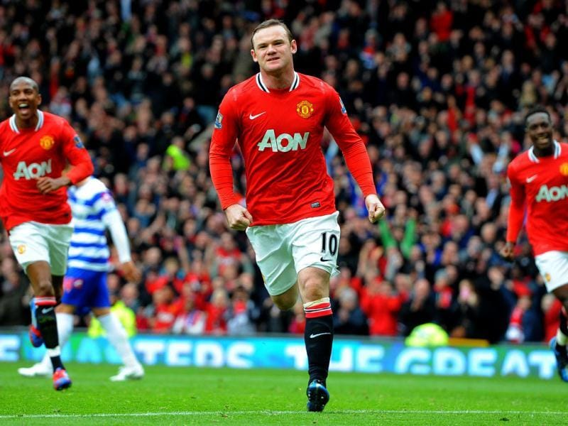 Manchester United's English forward Wayne Rooney celebrates after scoring the opening goal from a penalty during the English Premier League football match between Manchester United and Queens Park Rangers at Old Trafford in Manchester. AFP