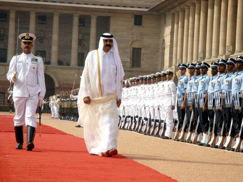 Emir of the State of Qatar, Sheikh Hamad Bin Khalifa Al-Thani inspects a guard of honour during a ceremonial reception at Rashtrapati Bhavan in New Delhi.