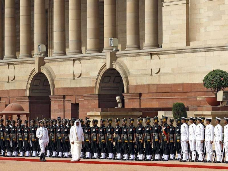 Qatar's emir, Sheikh Hamad bin Khalifa Al Thani inspects a guard of honour during his ceremonial reception at the Presidential Palace in New Delhi. AP/Saurabh Das