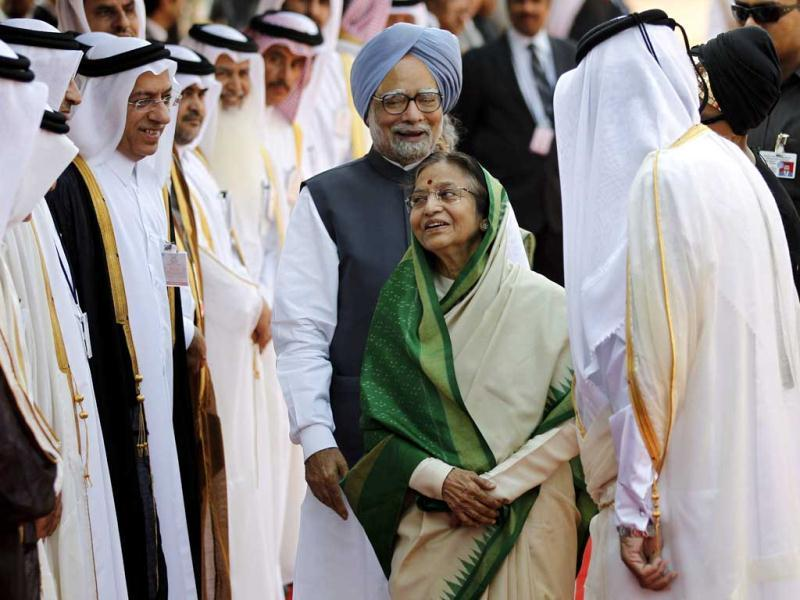 Prime Minister Manmohan Singh and President Pratibha Patil share a laugh as Qatar's Emir, Sheikh Hamad bin Khalifa Al Thani, second from right, jokes while introducing dignitaries traveling with him, during his ceremonial reception at the Presidential Palace in New Delhi. AP/Saurabh Das