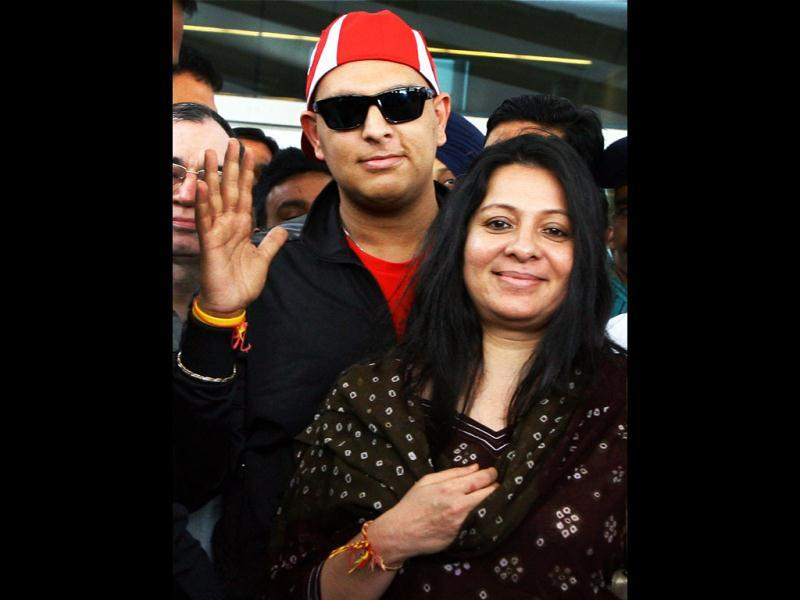 Yuvi was received by his mother Shabnam at the Indira Gandhi International Airport in New Delhi. PTI Photo by Kamal Kishore