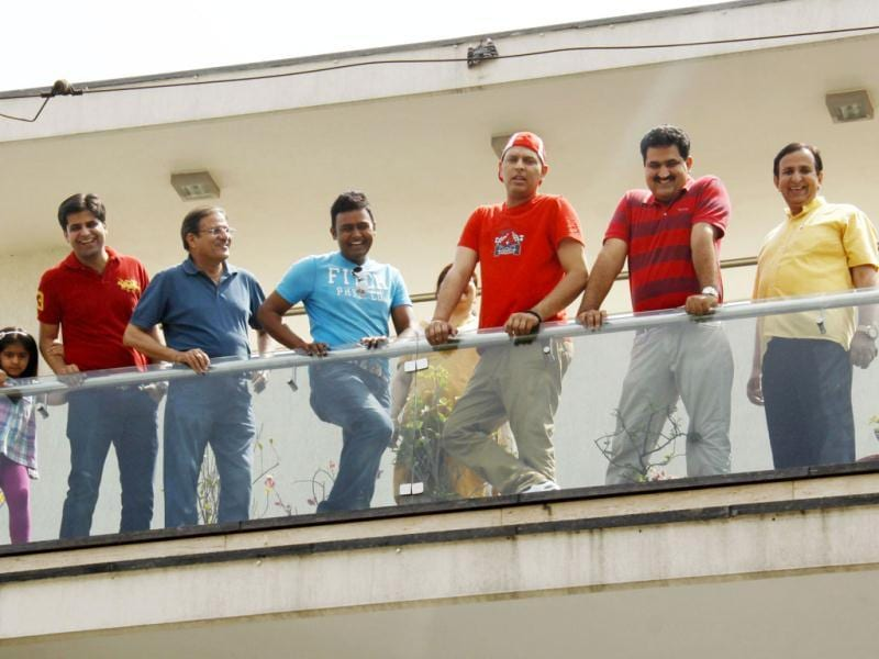 Cricketer Yuvraj Singh interacts with the media and fans from the terrace of his residence in Gurgaon. Yuvraj returned home on Monday after undergoing a successful treatment for cancer in the US and spending some time in London. HT Photo/Manoj Kumar