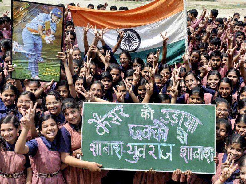 Children take part in a programme to welcome cricketer Yuvraj Singh's return at their school in Moradabad. Yuvraj returned home after undergoing treatment of cancer in the US and spending some time in London. PTI Photo