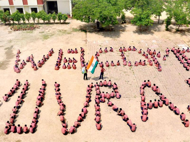 Children make a human chain to welcome cricketer Yuvraj Singh's return at their school in Moradabad. Yuvraj returned home after undergoing treatment of cancer in the US and spending some time in London. PTI Photo