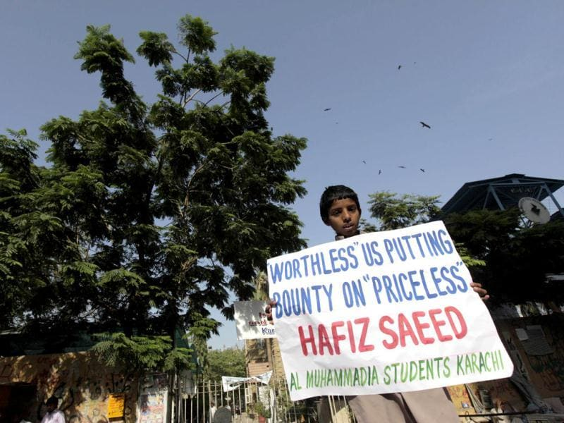 A supporter of Al Muhammadia Students, a religious group, holds a placard while taking part with dozens others in an anti-American rally in Karachi. Dozens of students gathered in a rally to condemn the American decision to place a $10 million bounty on its leader Hafiz Saeed, the Islamist suspected of masterminding the 2008 Mumbai attack. (Reuters)