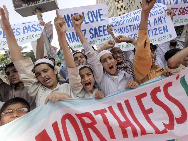Supporters of Al Muhammadia Students, a religious group, shout slogans while taking part in an anti-American rally in Karachi. Dozens of students gathered in a rally to condemn the American decision to place a $10 million bounty on its leader Hafiz Saeed, the Islamist suspected of masterminding the 2008 Mumbai attack. (Reuters)