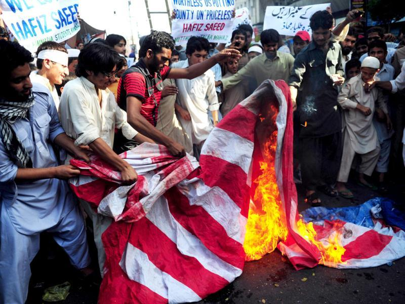 Pakistani religious students of Muttahida Talba Mahaz, set fire to a US flag during a protest rally in Karachi. Protesters condemned a $10 million bounty slapped on the founder of a terror group. The Defence Council of Pakistan, an alliance of right-wing, religious and extremist groups, organised the rallies to denounce the move against Hafiz Saeed, whose Lashkar-e-Taiba group was blamed for the 2008 Mumbai attacks in India.(AFP Photo)