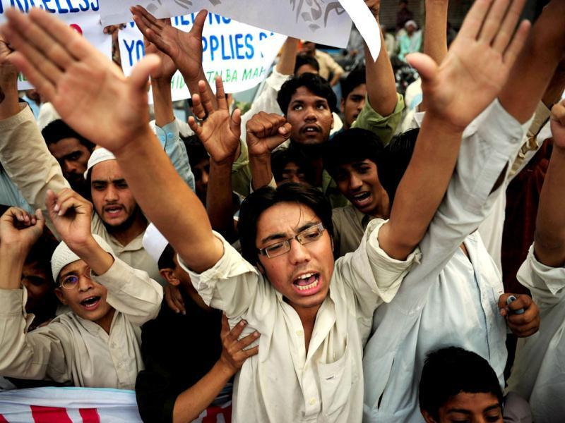 Pakistani religious students of Muttahida Talba Mahaz, shout anti-US slogans during a protest rally in Karachi. Protesters condemned a $10 million bounty slapped on the founder of a terror group. The Defence Council of Pakistan, an alliance of right-wing, religious and extremist groups, organised the rallies to denounce the move against Hafiz Saeed, whose Lashkar-e-Taiba group was blamed for the 2008 Mumbai attacks. (AFP Photo)