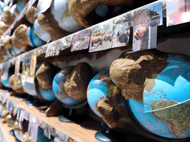 'Outgrowth' globes from Swiss artist Thomas Hirschhorn are displayed during the exhibition 'Les maitres du desordre' focused on shamanism, on at the Quai Branly Museum in Paris. AFP/Mehdi Fedouach