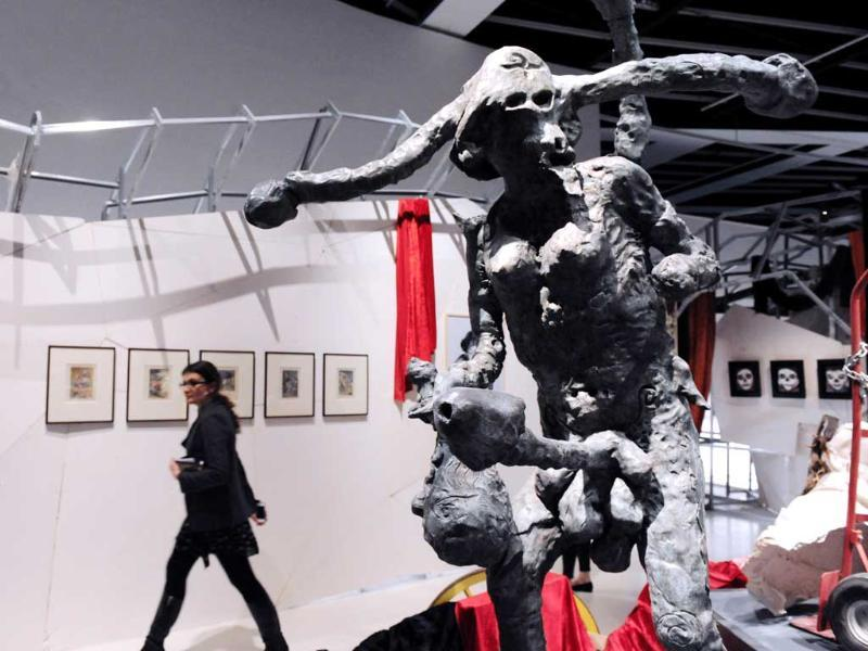 'Der Propagandist' bronze statue of German artist Jonathan Meese is displayed during the exhibition The Masters Of Disorder, focused on shamanism. AFP/Mehdi Fedouach