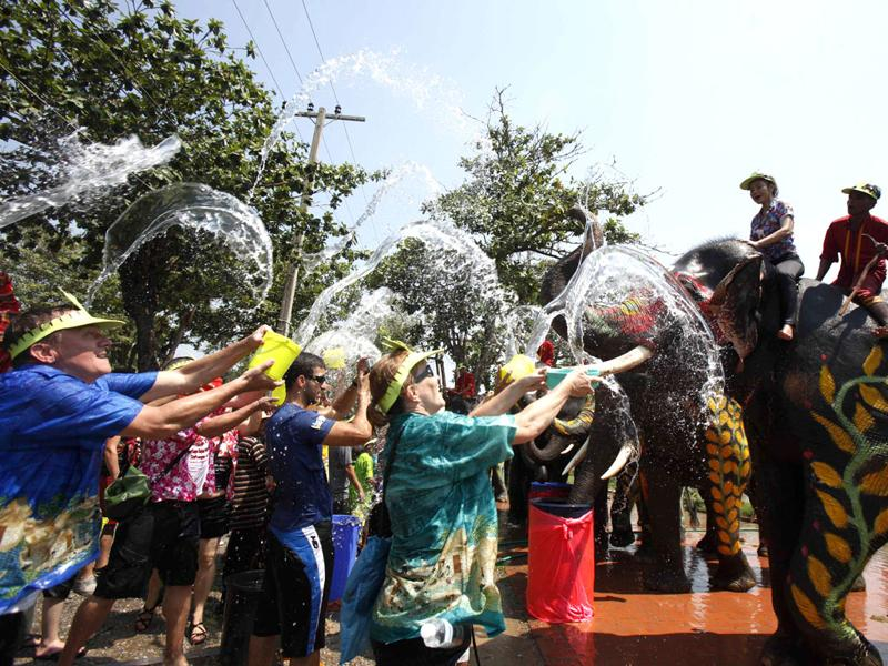 Tourists splash elephants with water during the Songkran water festival in Thailand's Ayutthaya province. Reuters/Chaiwat Subprasom