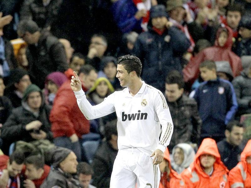Real Madrid's Cristiano Ronaldo from Portugal celebrates after scoring against Atletico de Madrid's during a Spanish La Liga soccer derby match at the Vicente Calderon stadium in Madrid. AP/Paul White