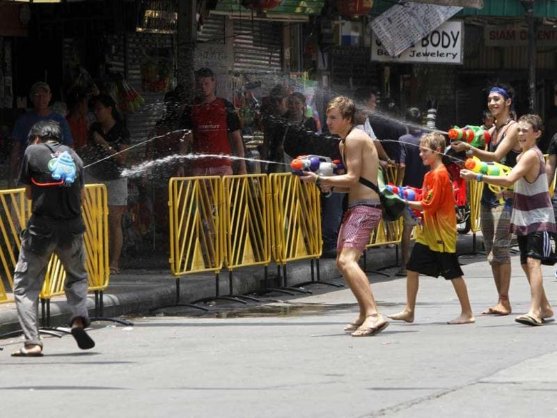 Tourists use water guns as they participate in a water fight with a local Thai during the Songkran Festival celebration at Khaosan road in Bangkok. The Songkran festival, also known as the water festival, marks the start of Thailand's traditional New Year and is believed to wash away bad luck. REUTERS/Chaiwat Subprasom