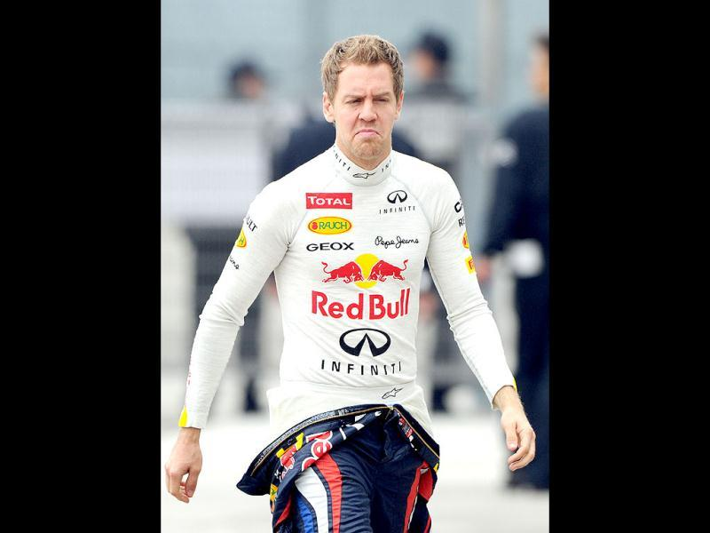 Red Bull Racing team and Formula One world champion Sebastian Vettel of Germany walks in the paddock before the first practice session of the Chinese Grand Prix at the Shanghai International Circuit. AFP/Mark Ralston