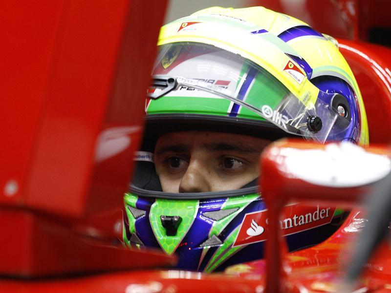 Ferrari Formula One driver Felipe Massa of Brazil waits in his car during practice for the Chinese Grand Prix in Shanghai, China. AP/Mark Baker