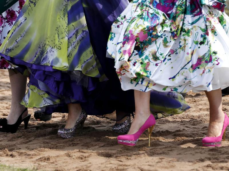 Colouful high-heeled shoes worn by the racegoers are seen as they cross the course as they arrive for Ladies' Day on the second day of the Grand National meeting at Aintree in Liverpool, northern England. Reuters/Phil Noble