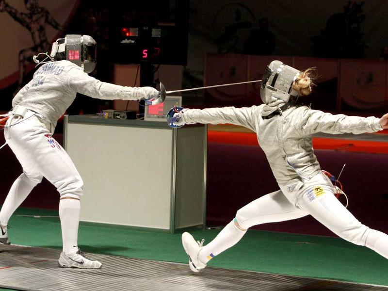 Olga Kharlan of Ukraine (R) and Ibtihaj Muhammad of the US compete during their women's sabre team semi-final competition at the World Fencing Championships in Kiev. REUTERS/Anatolii Stepanov