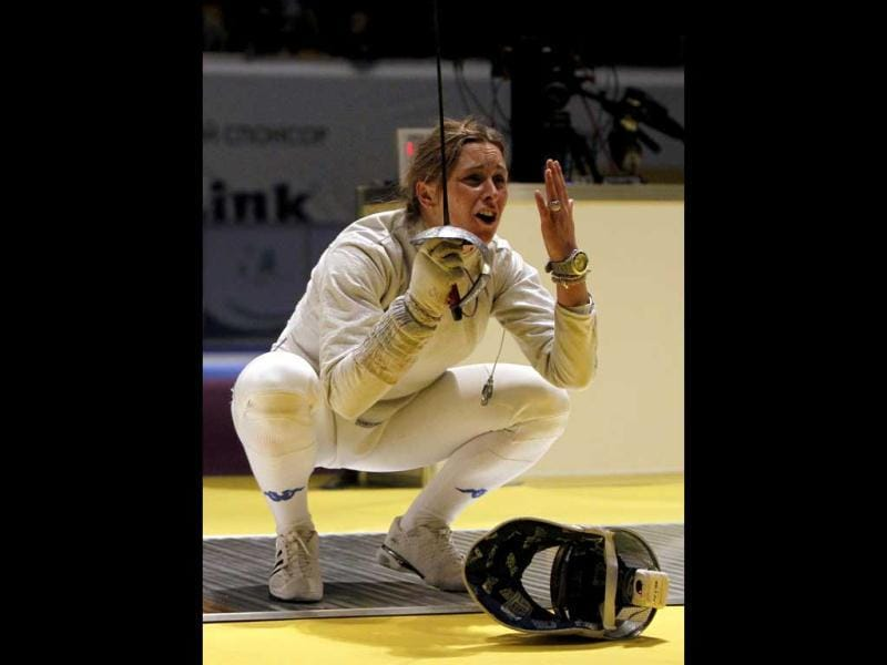 Gioia Marzocca of Italy reacts after loosing her women's sabre team semi-final competition against Yuliya Gavrilova of Russia at the World Fencing Championships in Kiev. REUTERS/Gleb Garanich
