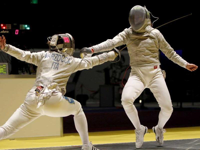 Yuliya Gavrilova of Russia (R) and Gioia Marzocca of Italy compete during their women's sabre team semi-final competition at the World Fencing Championships in Kiev. REUTERS/Gleb Garanich