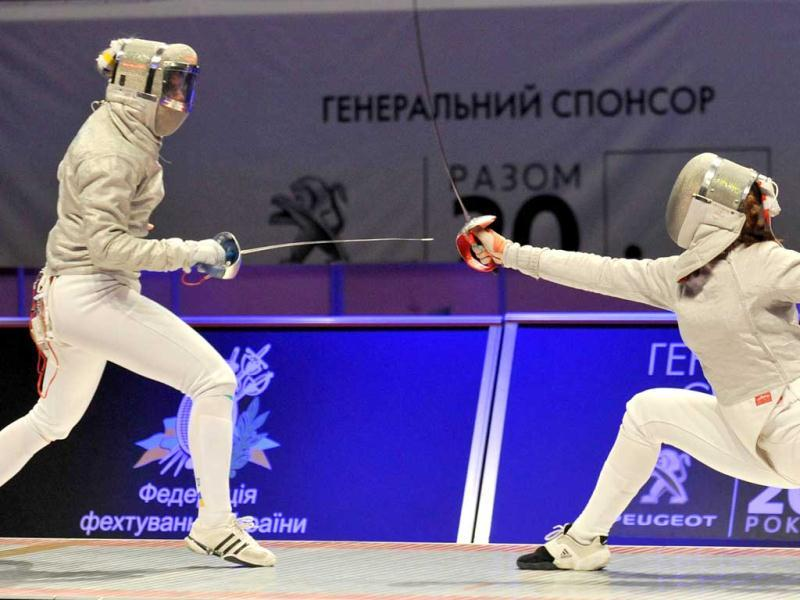 Russian Velikaya Sofya (R) fights Kharlan Olga (L) of Ukraine during the women's team sabre final competition at the 2012 World Fencing Championships in Kiev. AFP PHOTO /GENYA SAVILOV