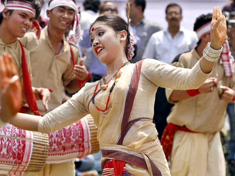 Assamese dancers perform the Bihu, a folk dance, during celebrations to mark Rongali Bihu festival in Guwahati. Rongali Bihu marks the onset of the Assamese New Year and the coming of spring. AP Photo/Anupam Nath