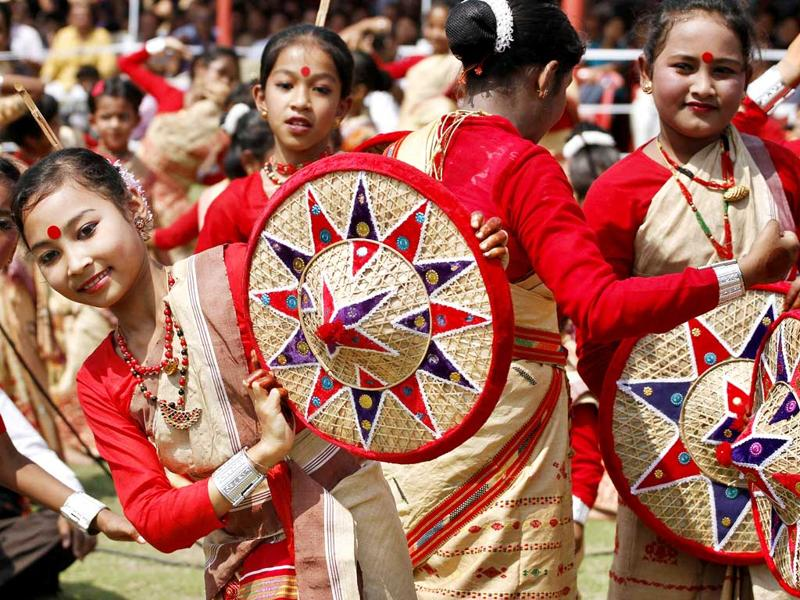 Assamese dancers perform the Bihu, a folk dance, during celebrations to mark Rongali Bihu festival in Guwahati, India. Rongali Bihu marks the onset of the Assamese New Year and the coming of spring. AP Photo/Anupam Nath