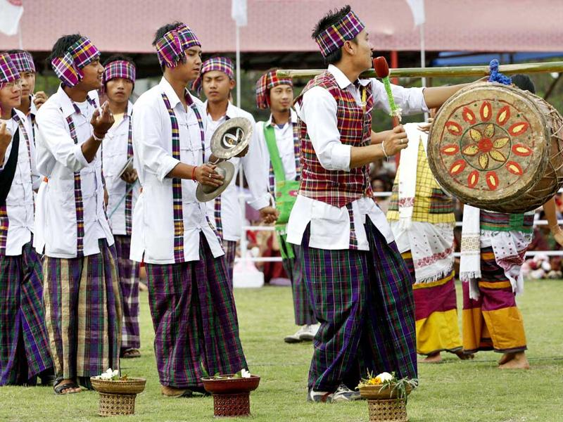 Assamese men in traditional dress perform the Bihu, a folk dance, during celebrations to mark Rongali Bihu festival in Gauhati. Rongali Bihu marks the onset of the Assamese New Year and the coming of spring. AP Photo/Anupam Nath